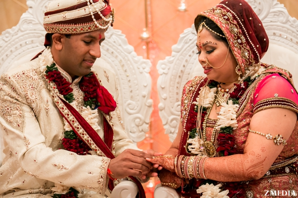 indian bride and groom exchange rings at indian wedding ceremony
