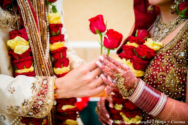 Indian bride wears red wedding lengha and traditional indian wedding jewelry.