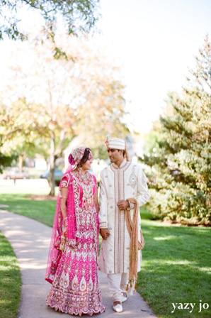 Indian bride and groom take indian wedding portraits at indian wedding venue