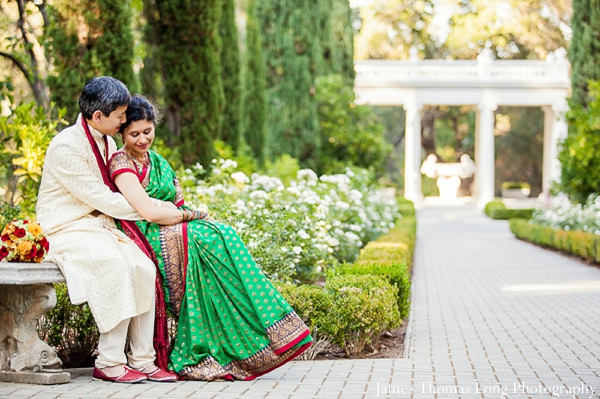 Fusion indian wedding couple wears traditional wedding outfits.
