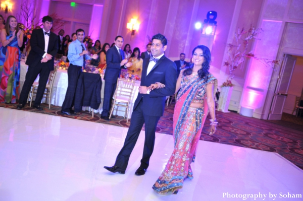 indian bride and groom enter indian wedding reception.
