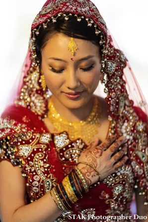Fusion indian bride with bridal hair and makeup ideas.