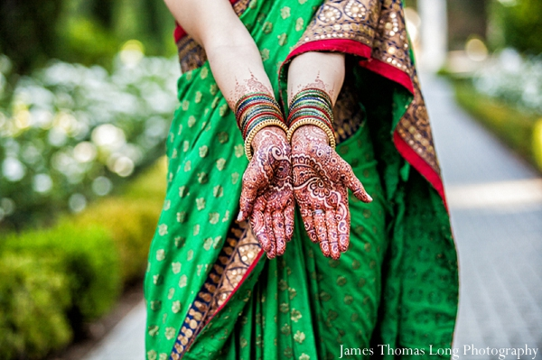South Indian bride shows off her bridal mehndi.