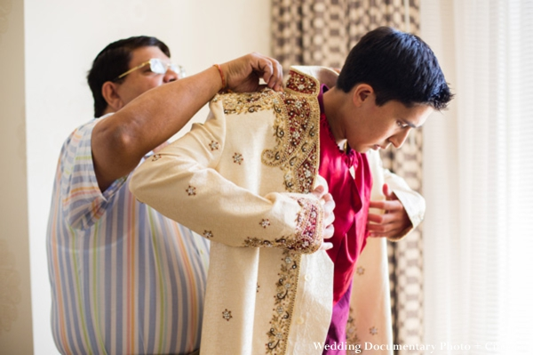 Indian groom puts on cream sherwani for indian wedding