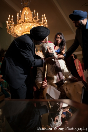 Indian groom wears veil at his indian wedding
