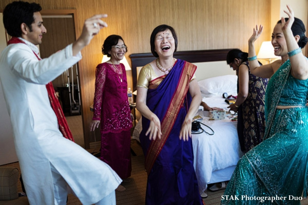 Indian wedding begins with family in wedding saris.