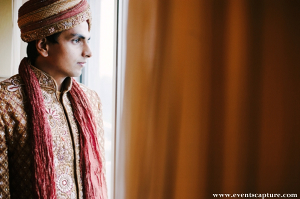 Indian groom in traditional indian wedding outfit