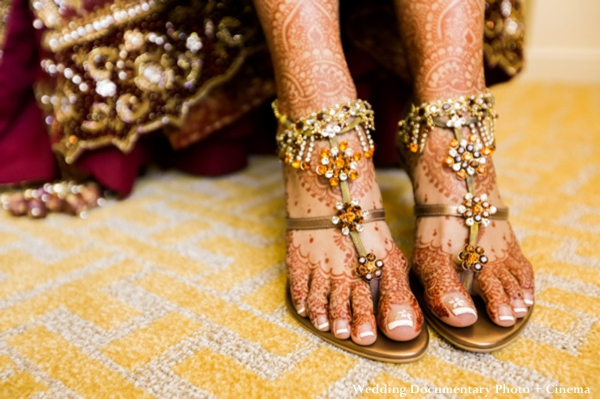 Indian bride with bridal henna on feet.