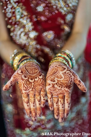 Indian bride wears bridal mehndi designs on her palms