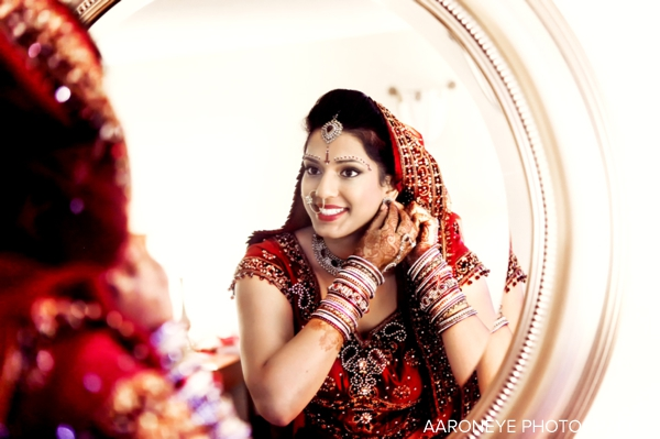 Indian bride in red wedding lengha with indian bridal jewelry
