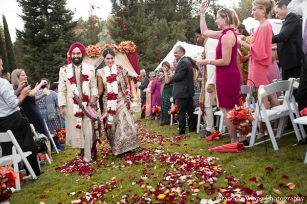 Indian bride in bridal lengha with long jaimala flower garland