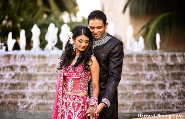 Indian bride wears hot pink wedding lengha.