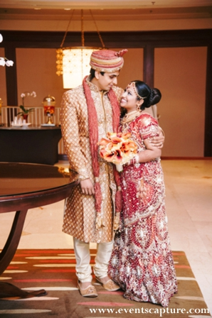Indian bride and groom in traditional indian wedding wear.