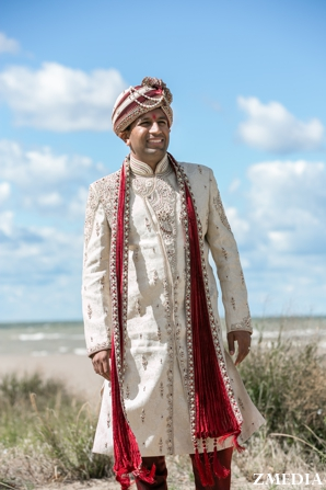 indian groom wedding portrait in traditional wedding outfit