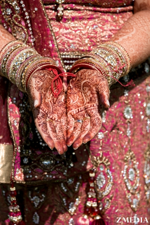 Indian bridal mehndi or henna on Indian bride's hands