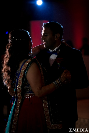 indian bride and groom dance at indian wedding reception