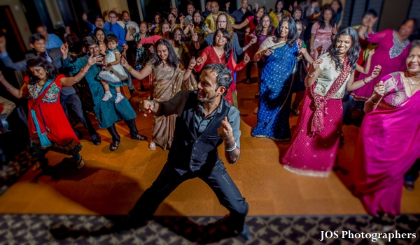 Indian wedding guests dance at south indian wedding