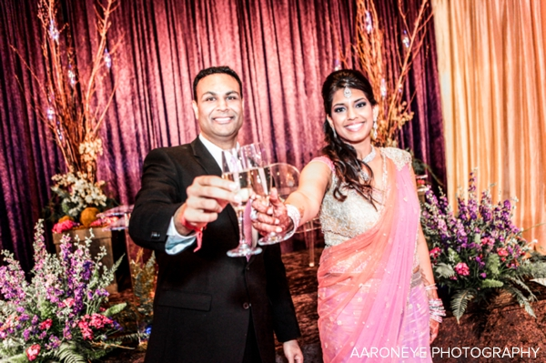 Indian bride in pink lengha at modern indian wedding reception