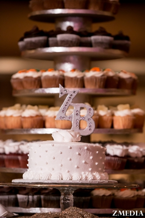 Indian wedding cake with monogram topper and cupcake tower
