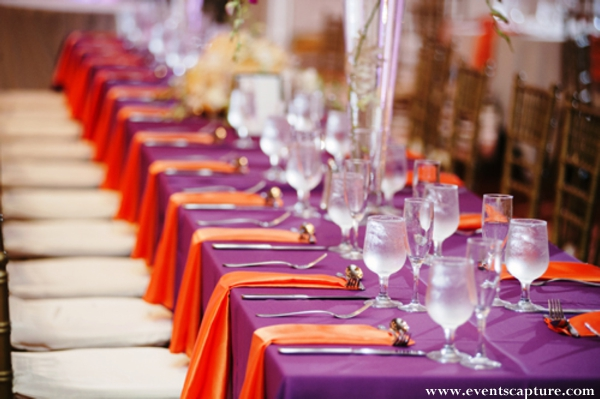 Indian wedding reception table in orange and purple