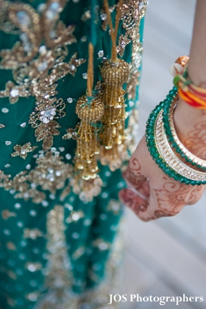 indian bride wears teal wedding lengha with matching churi bracelets