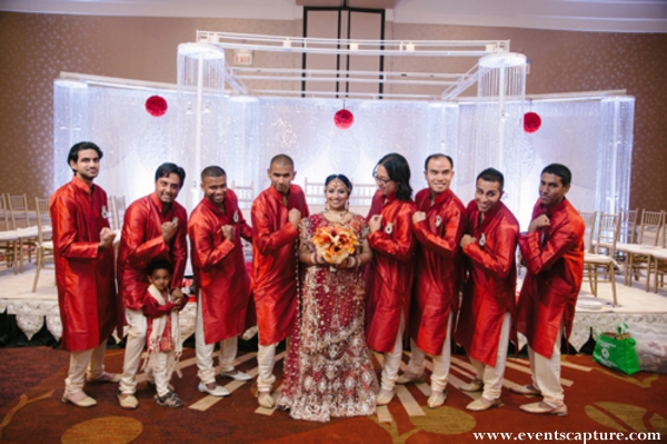 Indian bride with her Indian wedding groomsmen in red kurtas.