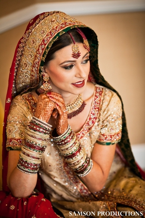 Pakistani bride in her traditional wedding outfit and jewelry.